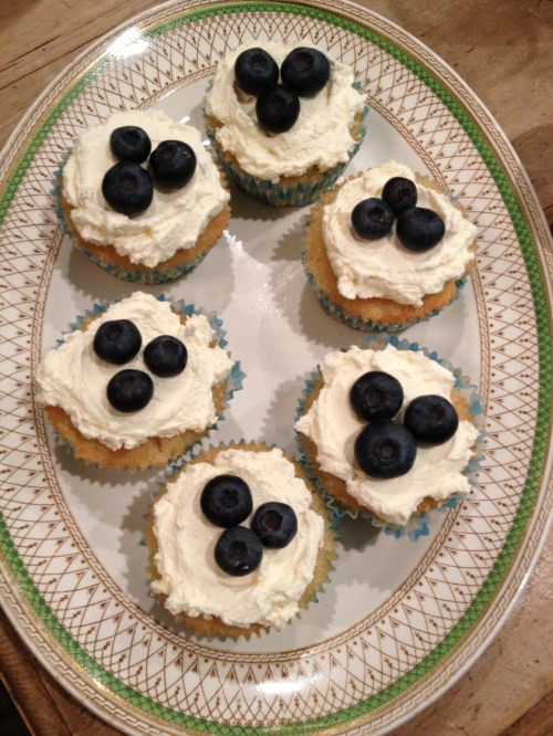 Lemon drizzle cupcakes with lemon curd cream and blueberries