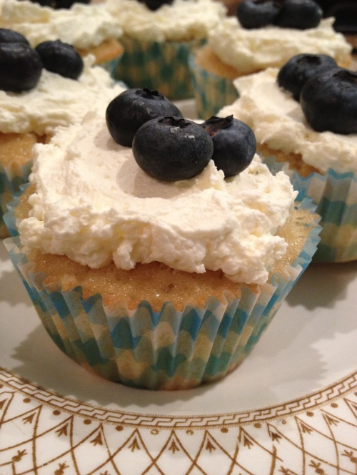 Lemon drizzle cupcake with lemon curd cream and blueberries