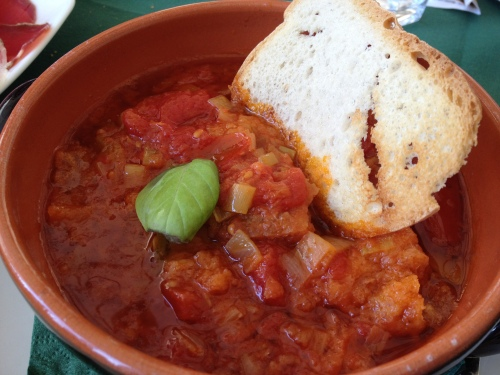 Stale bread with tomatoes & garlic served warm at Osteria del Borgo